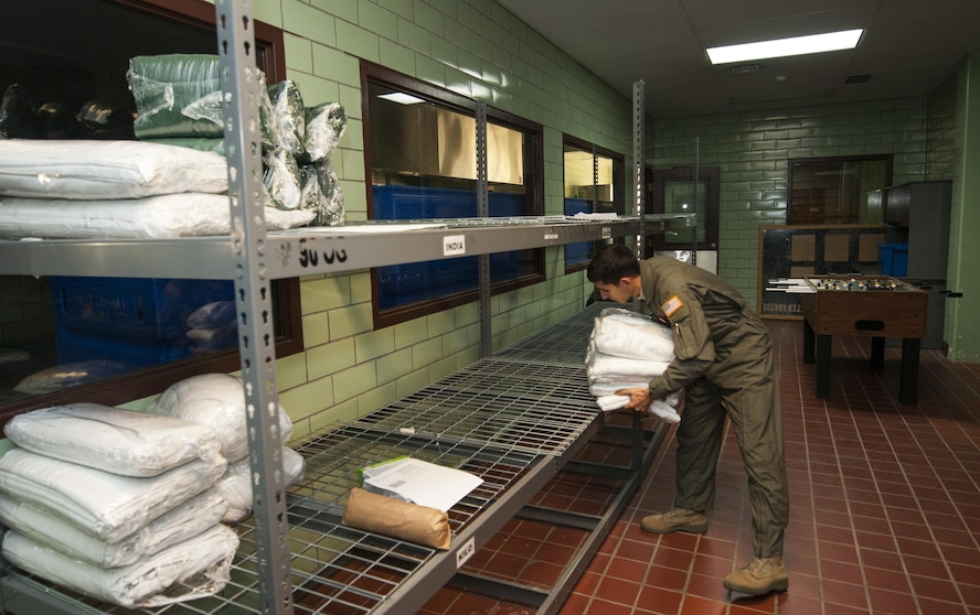 Second Lt. Nikolas Ramos, deputy missile combat crew commander, retrieves linen from a 90th Force Support Squadron facility at F.E. Warren Air Force Base, Wyo., Nov. 5, 2016. Before departing base, missileers pick up supplies requested by missile alert facility managers and chefs. (U.S. Air Force photo by Staff Sgt. Christopher Ruano)