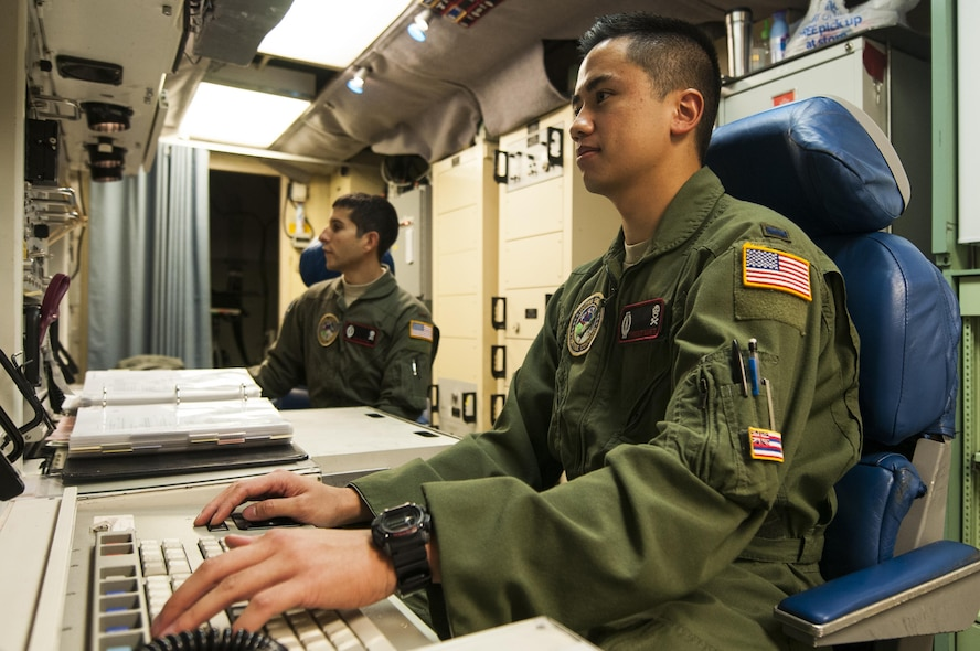 """First Lt. Terrence Dale Duarte, 320th Missile Squadron missile combat crew commander and 2nd Lt. Nikolas Ramos, deputy missile combat crew commander, sit at the control console inside the launch control center at F.E. Warren Air Force Base, Wyo., Nov. 5, 2016. When directed by the U.S. President, a properly conducted key turn sends a """"launch vote"""" to any number of Minuteman III ICBMs in a missileer's squadron, two different launch votes are required to enable a launch. (U.S. Air Force photo by Staff Sgt. Christopher Ruano)"""