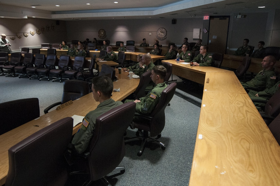 Missileers from the 90th Operations Group attend a pre-departure briefing at F.E. Warren Air Force Base, Wyo., Nov. 5, 2016. The briefing details the conditions of the 90th Missile Wing missile complex including weather forecasts and road conditions for their travel. (U.S. Air Force photo by Staff Sgt. Christopher Ruano)