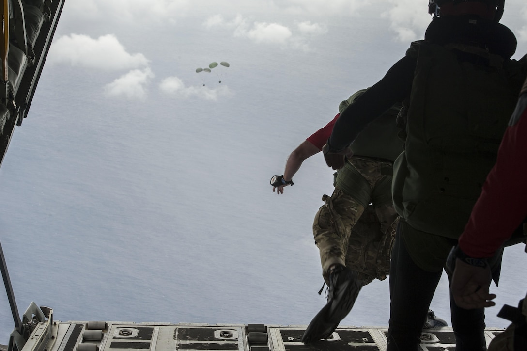 Pararescuemen from the 31st Rescue Squadron jump out of an MC-130J Commando II during Exercise Keen Sword Nov. 10, 2016, off the coast of Okinawa, Japan. Exercises like Keen Sword demonstrate the ability of rescue teams to quickly gather resources and respond to a situation. (U.S. Air Force photo by Senior Airman Lynette M. Rolen/Released)