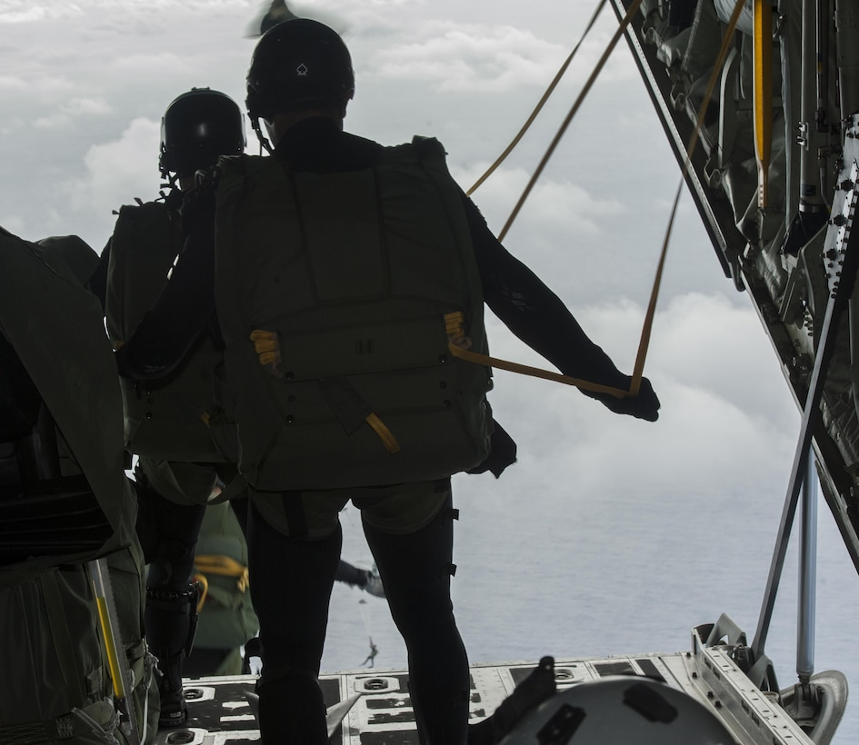 Japan Air Self-Defense Force pararescuemen jump out of an MC-130J Commando II during Exercise Keen Sword 17 Nov. 10, 2016, off the coast of Okinawa, Japan. Keen Sword is an annual exercise which strengthens interoperability between JASDF and U.S. combat rescue teams. (U.S. Air Force photo by Senior Airman Lynette M. Rolen/Released)