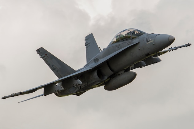 A U.S. Marine Corps F/A-18D Hornet takes off from Sam Ratulangi International Airport, Indonesia, during exercise Cope West 17, Nov. 8, 2016. This fighter-focused, bilateral exercise between the U.S. Marine Corps and Indonesian Air Force is designed to enhance the readiness of combined interoperability between the two nations. The squadron plans to complete their unit air-to-air training requirements, which focuses on basic fighter maneuvering, section engaged maneuvering, offensive anti-air warfare and active air defense versus the Indonesian Air Force to increase situational readiness, interoperability, knowledge and partnership between the U.S. and Indonesia. (U.S. Marine Corps photo by Cpl. Aaron Henson)