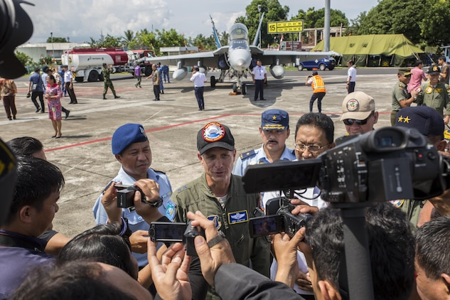 Indonesian media interview U.S. Air Force Maj. Gen. Mike Compton, Air National Guard assistant to the commander, Pacific Air Forces, during a closing ceremony for exercise Cope West 17 at Sam Ratulangi International Airport, Indonesia, Nov. 11, 2016. First conducted in 1989, Cope West is a Pacific Air Force lead exercise, normally focusing on airlift, air-land and air drop delivery operation techniques. Cope West 17 is the first fighter-focused exercise in Indonesia in 19 years involving the U.S. Military and the Indonesian Air Force. (U.S. Marine Corps photo by Cpl. Aaron Henson)