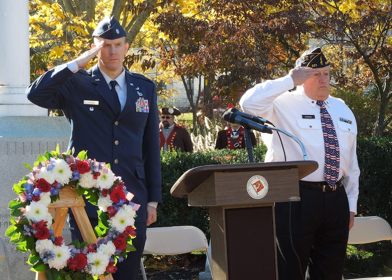 Lt. Col. Kenneth A. Ferland, 66th Air Base Group deputy commander, and Jon O'Connor, commander of American Legion Post 221, salute as the national anthem plays during a Veterans Day ceremony in Bedford, Mass., Nov. 11. Several local towns surrounding Hanscom honored military service members during Veterans Day observances. (Courtesy photo)