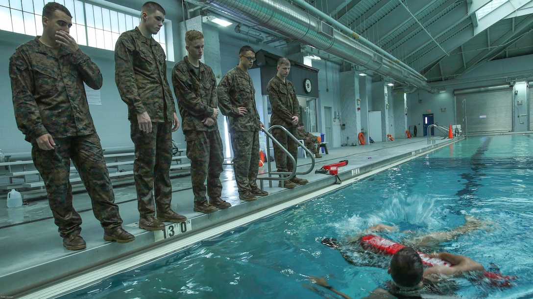 Marines watch Sgt. Sasha McFadden as he explains a buddy rescue drill during an advanced water survival course at Camp Lejeune, N.C., Nov. 8, 2016. The course was aimed toward qualifying Marines as advanced swimmers, the highest level in the Marine Corps Water Survival Training Program.