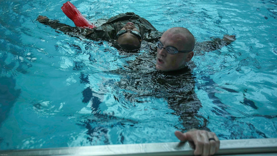 Marines perform one of four survival strokes during an advanced water survival qualification course at Camp Lejeune, N.C., Nov. 8, 2016. The course taught Marines multiple survival strokes, saving distressed victims in the water and boosted underwater confidence.