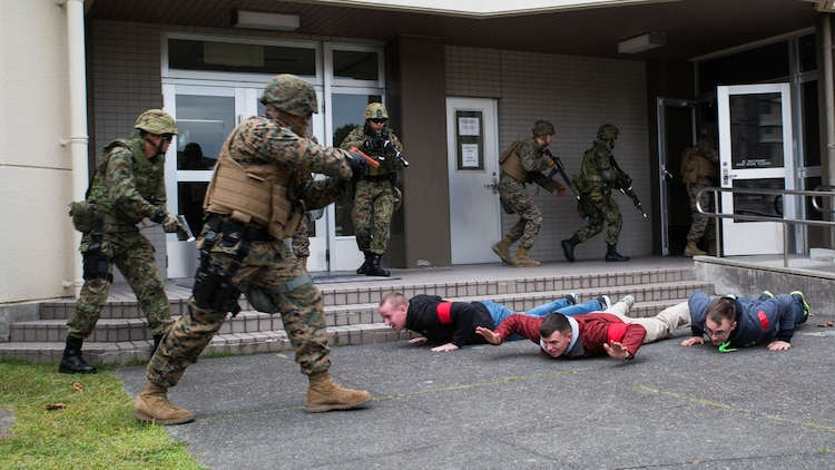 U.S. Marines and Japan Ground Self-Defense Force members executed exercise Active Shield at Marine Corps Air Station Iwakuni, Japan, Nov. 10, 2016. Active Shield is an annual exercise designed to test the abilities of U.S. and Japanese forces to work alongside each other to protect and defend Marine Corps Air Station Iwakuni and other U.S. assets in the region.
