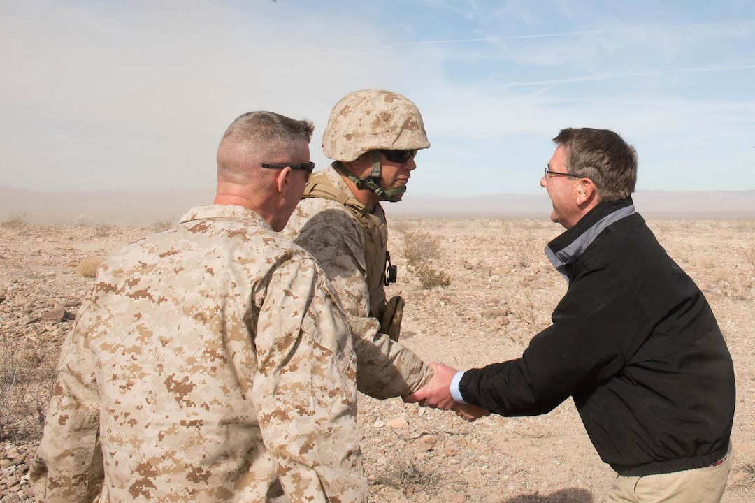 Defense Secretary Ash Carter shakes hands with Marines before observing a training exercise at Marine Corps Air Ground Combat Center.