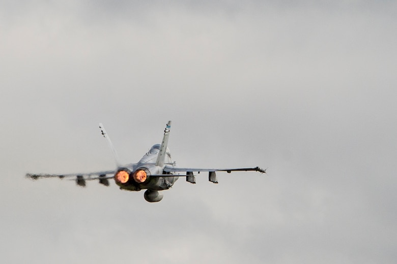 A U.S. Marine Corps F/A-18D Hornet takes off from Sam Ratulangi International Airport, Indonesia during exercise Cope West 17, Nov. 8, 2016. The combined training offered by this exercise helps prepare the U.S. Marine Corps and Indonesia Air Force to work together in promoting a peaceful Indo-Asia-Pacific region while practicing close air support and air-to-air training that will enhance their ability to respond to contingencies throughout the region.