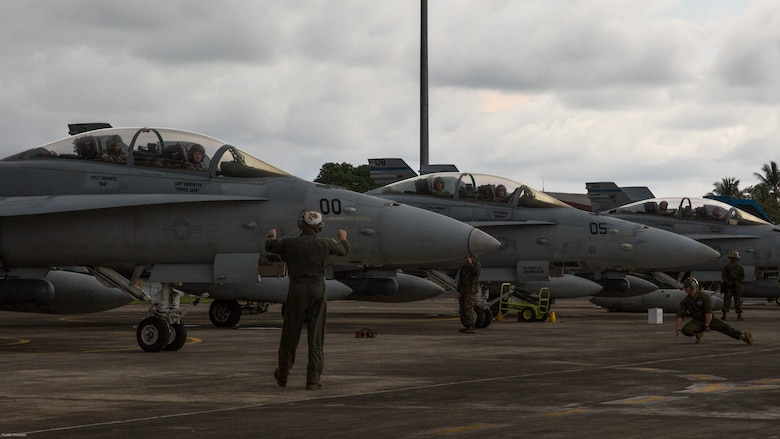 U.S. Marine Corps F/A-18D Hornets with Marine All-Weather Fighter Attack Squadron 225 prepare for takeoff during exercise Cope West 17 at Sam Ratulangi International Airport, Indonesia, Nov. 10, 2016. This fighter-focused, bilateral exercise between the U.S. Marine Corps and Indonesian Air Force is designed to enhance the readiness of combined interoperability between the two nations.