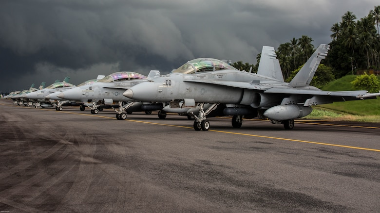 U.S. Marine Corps F/A-18D Hornets with Marine All-Weather Fighter Attack Squadron 225 and Indonesian F-16 Fighting Falcons sit on the flight line during exercise Cope West 17 at Sam Ratulangi International Airport, Indonesia, Nov. 10, 2016. This fighter-focused, bilateral exercise between the U.S. Marine Corps and Indonesian Air Force is designed to enhance the readiness of combined interoperability between the two nations.