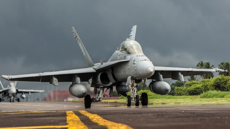 A U.S. Marine Corps F/A-18D Hornet with Marine All-Weather Fighter Attack Squadron 225 taxis down the flight line during exercise Cope West 17 at Sam Ratulangi International Airport, Indonesia, Nov. 10, 2016. This fighter-focused, bilateral exercise between the U.S. Marine Corps and Indonesian Air Force is designed to enhance the readiness of combined interoperability between the two nations.