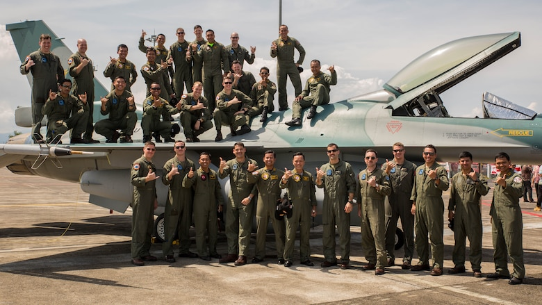 U.S. Marines with Marine All-Weather Fighter Attack Squadron 225 and Indonesian Air Force service members pose for a photo with an Indonesian Air Force F-16 Fighting Falcon during a closing ceremony for exercise Cope West 17 at Sam Ratulangi International Airport, Indonesia, Nov. 11, 2016. The combined training offered by this exercise helps prepare the U.S. Marine Corps and Indonesia Air Force to work together in promoting a peaceful Indo-Asia-Pacific region while practicing close air support and air-to-air training that will enhance their ability to respond to contingencies throughout the region.