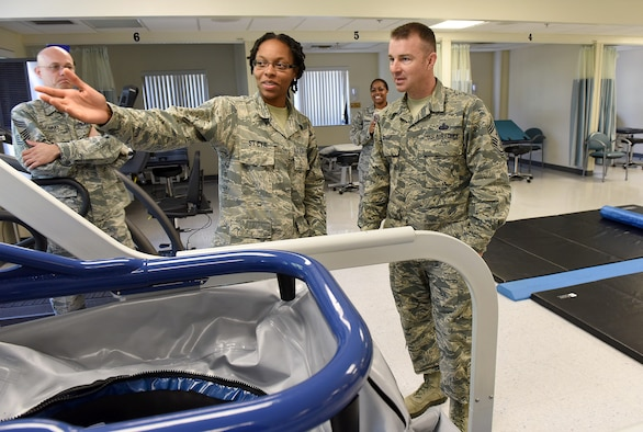 Senior Airman Jessica St. Cyr, 78th Medical Group physical therapist, guides Chief Master Sgt. Gary Sharp, Air Force Sustainment Center command chief, through the unit's physical therapy section during a recent visit to Robins Air Force Base, Ga.  (U.S. Air Force photos by Tommie Horton