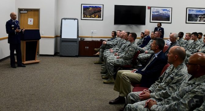 Col. David Miller, 460th Space Wing commander, addresses the audience for closing remarks, Nov. 10, 2016, at Buckley Air Force Base, Colo.  Members of Team Buckley gathered for a short Veterans Day speech presented by Chief Master Sgt. (ret.) Rene Simard, a prior command chief at Buckley AFB. (U.S. Air Force photo by Airman Holden S. Faul/ Released)