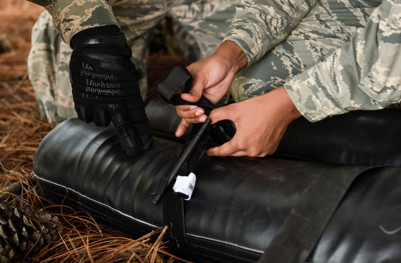 U.S. Air Force Staff Sgt. Max Rasmussen, 628th Medical Group member and Airman 1st Class Adaijah Rouse-Powell, 628th Force Support Squadron member, apply a tourniquet to a simulated casualty during the first Joint Base Charleston Combat Skills Training course here, Sept. 28, 2016. Feedback from members, hand selected to participate in the course, assisted base leadership and CST instructors determine how to improve the course for future Team Charleston service members.