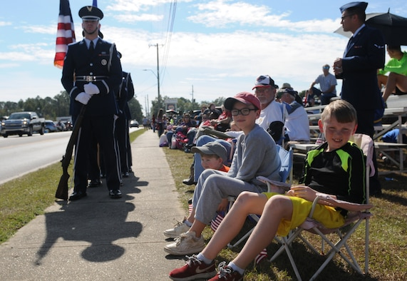 Attendees wait for the 16th Annual Gulf Coast Veterans Day Parade to begin Nov. 12, 2016, in D'Iberville, Miss. More than 5,000 Mississippi and Louisiana citizens watched the parade honoring Gulf Coast veterans. Keesler Honor Guard members, base leadership and more than 215 81st Training Group Airmen with the 50 State Flag Team and Drum and Bugle Corps also came out to celebrate the holiday. (U.S. Air Force photo by Senior Airman Holly Mansfield)