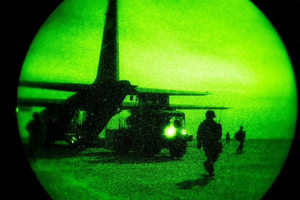 A 746th Expeditionary Airlift Squadron C-130 Hercules is unloaded by a 821st Contingency Response Group forklift during blackout conditions at Qayyarah West Airfield, Iraq, in support of Combined Joint Task Force - Operation Inherent Resolve, Nov. 12, 2016. The 746th EAS is actively engaged in tactical airlift operations supporting the Mosul offensive.(U.S. Air Force photo by Senior Airman Jordan Castelan)
