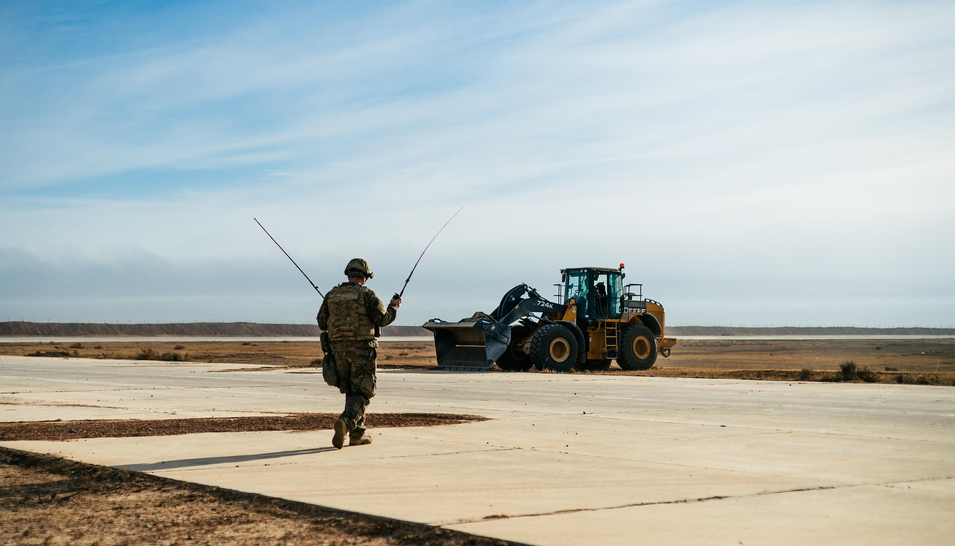 U.S. Air Force Master Sgt. Bradley Rich, 821st Contingency Response Group air traffic controller, prepares to land an Iraqi C-130 at Qayyarah West Airfield, Iraq, in support of Combined Joint Task Force - Operation Inherent Resolve, Nov. 13, 2016. The 821st CRG is actively engaged in tactical airlift operations supporting the Mosul offensive. (U.S. Air Force photo by Senior Airman Jordan Castelan)