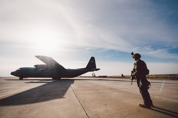Senior Airman Zachery Hatfield, 821st Contingency Response Squadron crew chief, provides airfield security for an Iraqi air force C-130 at Qayyarah West Airfield, Iraq, in support of Combined Joint Task Force - Operation Inherent Resolve, Nov. 13, 2016. The 821st CRG is highly-specialized in training and rapidly deploying personnel to quickly open airfields and establish, expand, sustain and coordinate air operations in austere, bare-base conditions. (U.S. Air Force photo by Senior Airman Jordan Castelan)