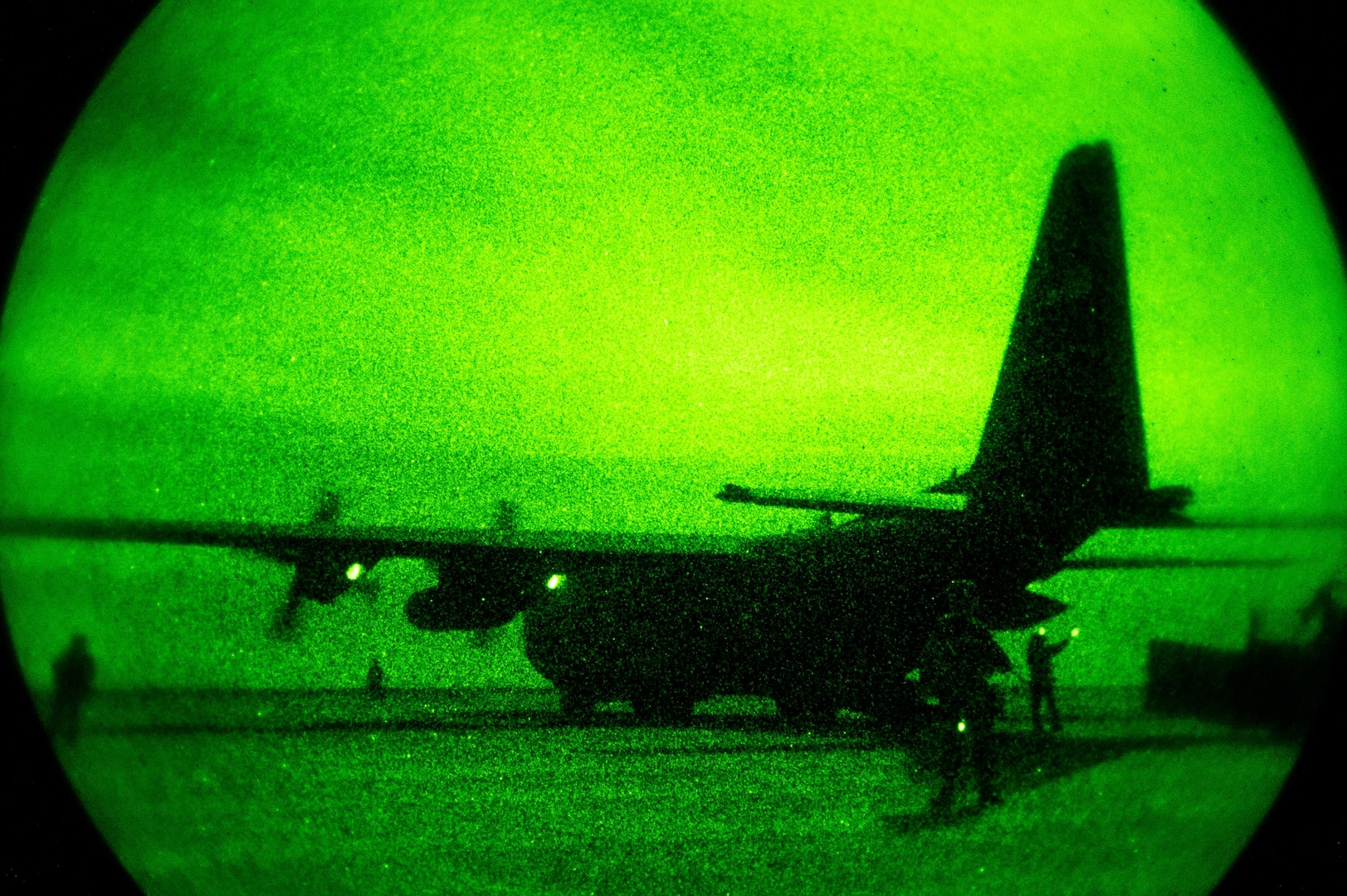 A 746th Expeditionary Airlift Squadron C-130 is guarded by members of a security forces team and 821st Contingency Response Group Airmen during blackout conditions while being unloaded by aerial porters at Qayyarah West Airfield, Iraq, in support of Combined Joint Task Force - Operation Inherent Resolve, Nov. 12, 2016. The 821st CRG is highly-specialized in training and rapidly deploying personnel to quickly open airfields and establish, expand, sustain and coordinate air operations in austere, bare-base conditions. (U.S. Air Force photo by Senior Airman Jordan Castelan)