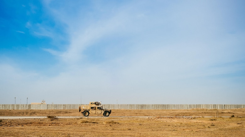 A 821st Contingency Response Group HUMVEE patrols the taxiway at Qayyarah West Airfield, Iraq, in support of Combined Joint Task Force - Operation Inherent Resolve, Nov. 13, 2016. The airfield at Qayyarah West was recaptured from Da'esh by Iraqi forces in July 2016, and has been refurbished by Coalition engineers to allow the re-commencement of air operations. Qayyarah Airfield is now a vital logistical hub, opening an air corridor in support of the battle to liberate Mosul as well as operations throughout northern Iraq. (U.S. Air Force photo by Senior Airman Jordan Castelan)
