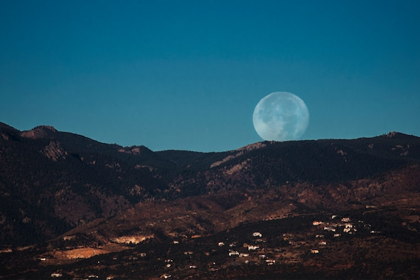 PETERSON AIR FORCE BASE, Colo. – A supermoon sets over the front range of the Rocky Mountains, Colo., Nov. 15, 2016. A supermoon is a coincidence of a full moon or a new moon with the closest approach the moon makes to the Earth on its elliptical orbit. (U.S. Air Force photo by Airman 1st Class Dennis Hoffman)