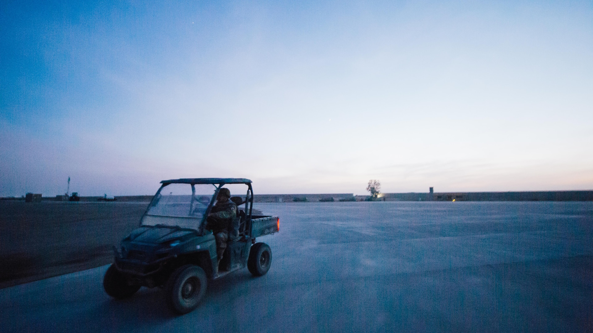 U.S. Air Force Staff Sgt. Steven Ramos, 821st Contingency Response Group airfield manager, drives a utility vehicle to a job site at Qayyarah West Airfield, Iraq, in support of Combined Joint Task Force - Operation Inherent Resolve, Nov. 14, 2016. The 821st CRG is highly-specialized in training and rapidly deploying personnel to quickly open airfields and establish, expand, sustain and coordinate air operations in austere, bare-base conditions. (U.S. Air Force photo by Senior Airman Jordan Castelan)