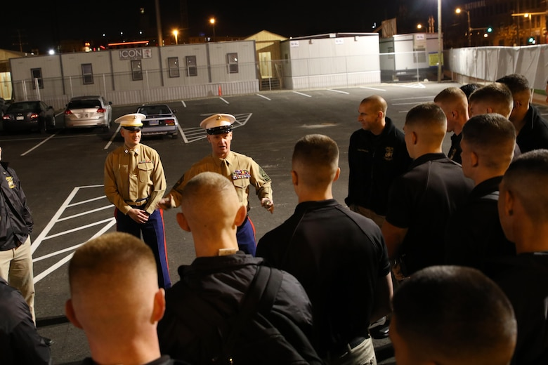 Sgt. Maj. Jason F. Wolken, the sergeant major of Recruiting Station Milwaukee, speaks with members of the Silent Drill Platoon prior to their performance at the Milwaukee Bucks game in downtown Milwaukee, Nov. 10, 2016. The platoon came to Milwaukee to demonstrate the precision and discipline that the Marine Corps is known across the world for having. This helps the efforts of the local recruiting station such as the one in Milwaukee, which is responsible for Marine Corps recruiting throughout Wisconsin.