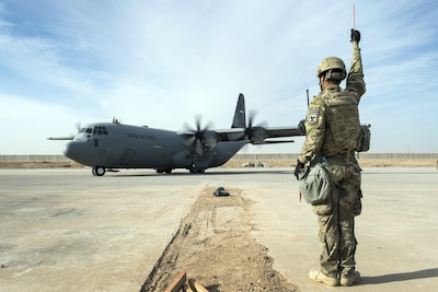 Senior Airman Zevon Davis, 821st Contingency Response Group aircraft maintainer, marshals out an Iraqi C-130 Hercules at Qayyarah Airfield West, Iraq, Nov. 13, 2016. Senior Airman Zevon Davis, 821st Contingency Response Group aircraft maintainer, marshals out an Iraqi C-130 Hercules at Qayyarah Airfield West, Iraq, Nov. 13, 2016. The airfield at Qayyarah West was recaptured from Da'esh by Iraqi forces in July 2016, and has been refurbished by Coalition engineers to allow the re-commencement of air operations. Qayyarah Airfield is now a vital logistical hub, opening an air corridor in support of the battle to liberate Mosul as well as operations throughout northern Iraq. (U.S. Air Force photo by Staff Sgt. Charles Rivezzo)