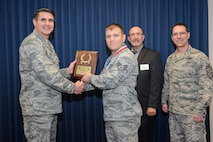 "Maj. Gen. Bradford J. ""BJ"" Shwedo (left), commander of 25th Air Force, along with Lee Anthony, executive council representative from the Freedom Through Vigilance Association and 25th AF Command Chief Master Sgt. Roger A. Towberman, presents a gold medal plaque to Staff Sgt. David Pettinelli, a noncommissioned officer-in-charge at the Air Force Technical Applications Center at Patrick AFB, Fla.  Pettinelli was recognized as a 2016 Maj. Gen. Doyle E. Larson Award winner as best scientific applications specialist in 25th AF.  (U.S. Air Force photo by William B. Belcher)"