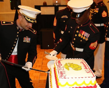 Major Michael L. Valenti slices the Marine birthday cake during the Recruiting Station Jacksonville's Marine Corps 241st Birthday Ball Celebration in Oct. 22, 2016 in Jacksonville, Florida. Valenti is the Commanding Officer of Recruiting Station Jacksonville.