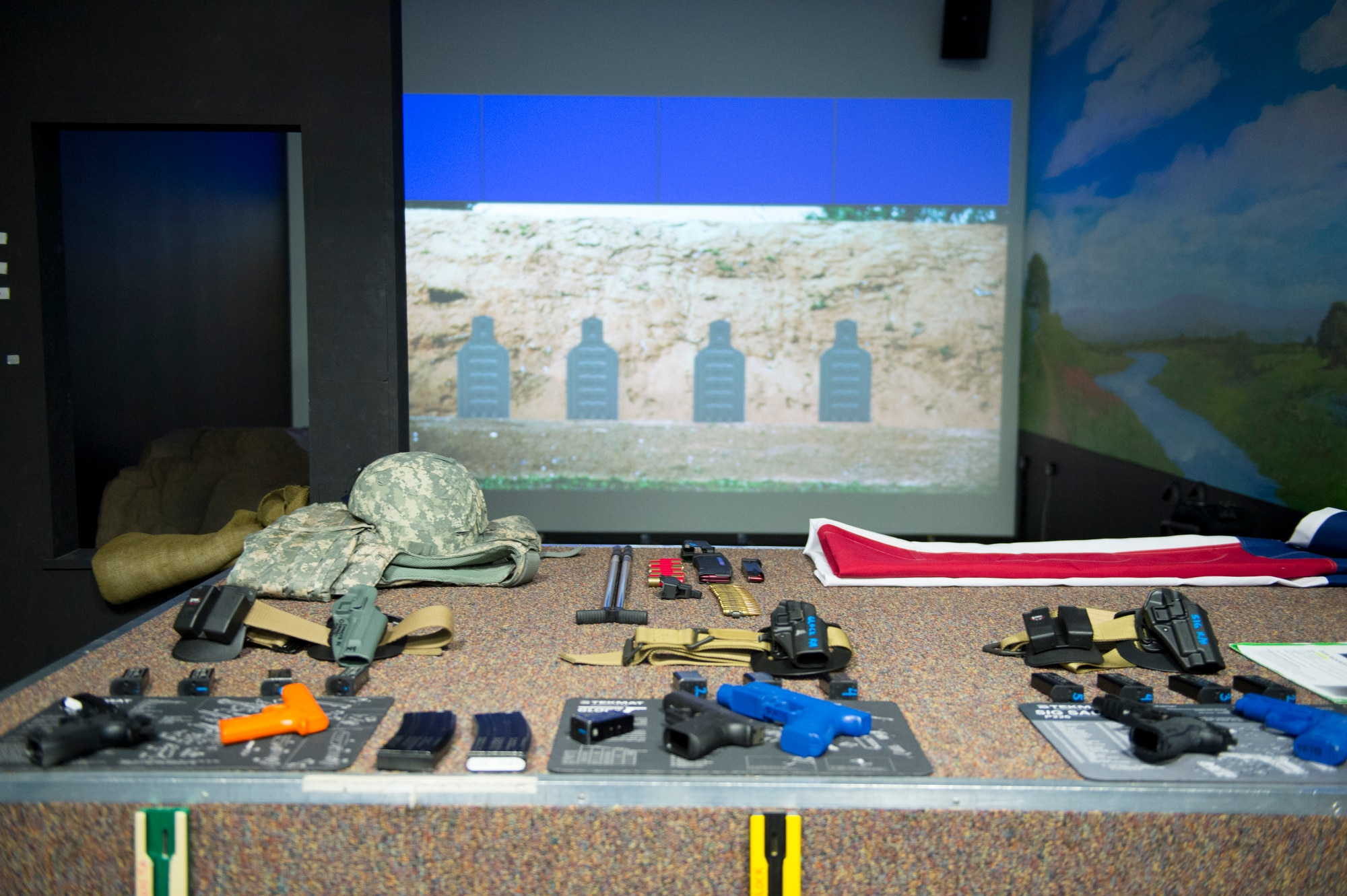 The Center for the Intrepid fire arms simulator provides service members that are recovering from traumatic brain injuries and amputations with a state-of-the-art indoor range on Fort Sam Houston, Texas, Sept. 13, 2016. The simulator provides tethered weapons, without live rounds, compressed nitrogen while simultaneously serving as a practice range for warriors that need the training for potential return to active-duty status. (U.S. Air Force photo/Tech Sgt. Vernon Young Jr.)