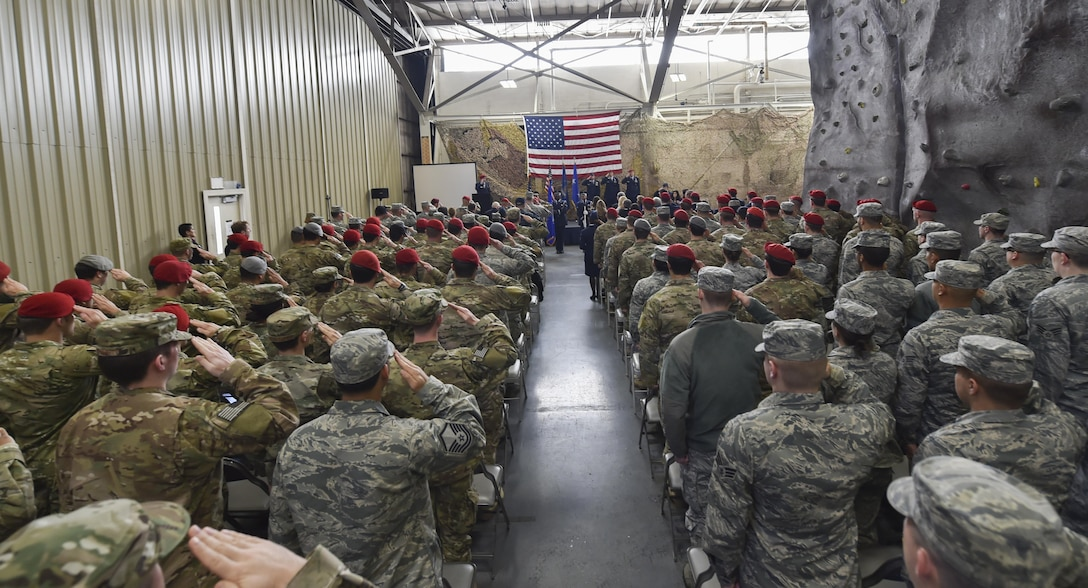 Airmen and soldiers salute during the National Anthem at a Silver Star Medal presentation ceremony at Joint Base Lewis-McChord, Wash., Nov. 16, 2016. The Silver Star Medal was presented to Staff Sgt. Keaton Thiem, a combat controller with the 22nd Special Tactics Squadron, for using air power to ensure the safety of his 100-plus man SOF element during a 14-hour firefight with no regard for his own personal safety, while deployed with U.S. Army Special Operations Forces in Afghanistan. (U.S. Air Force photo by Senior Airman Ryan Conroy)
