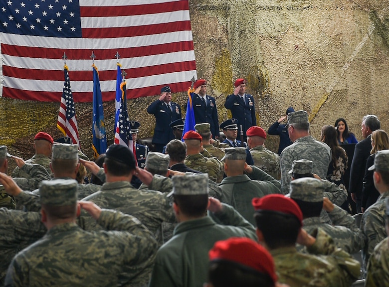 Airmen and soldiers salute during the National Anthem at a Silver Star Medal presentation ceremony at Joint Base Lewis-McChord, Wash., Nov. 16, 2016. The Silve Star Medal was presented to Staff Sgt. Keaton Thiem, a combat controller with the 22nd Special Tactics Squadron, for using air power to ensure the safety of his 100-plus man SOF element during a 14-hour firefight with no regard for his own personal safety, while deployed with U.S. Army Special Operations Forces in Afghanistan. (U.S. Air Force photo by Senior Airman Ryan Conroy)