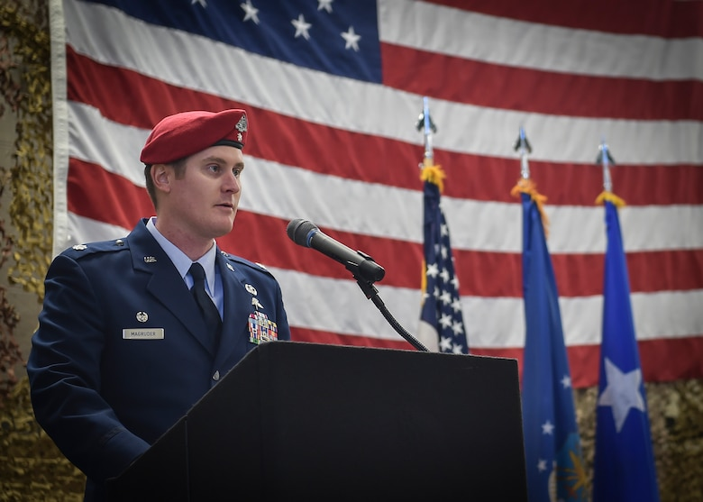 The commander of the 22nd Special Tactics Squadron, Lt. Col. Daniel Macgruder, speaks during a Silver Star Medal presentation ceremony to Staff Sgt. Keaton Thiem, a combat contoller, at Joint Base Lewis-McChord, Wash., Nov. 16, 2016. Thiem used air power to ensure the safety of his 100-plus man SOF element during a 14-hour firefight with no regard for his own personal safety, while deployed with U.S. Army Special Operations Forces in Afghanistan.(U.S. Air Force photo by Senior Airman Ryan Conroy)