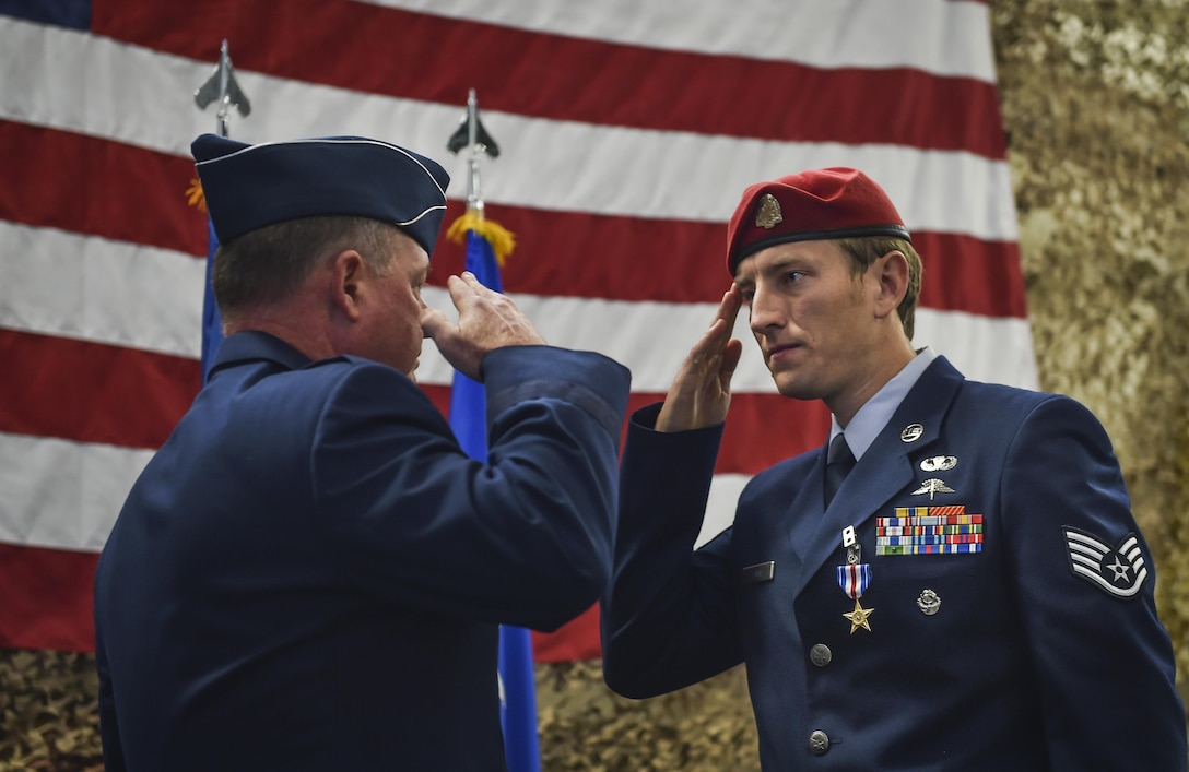 Staff Sgt. Keaton Thiem, a combat controller and Silver Star Medal recipient with the 22nd Special Tactics Squadron,  salutes Maj. Gen. Eugene Haase, vice commander of Air Force Special Operations Command, during a Silver Star Medal presentation ceremony at Joint Base Lewis-McChord, Wash., Nov. 16, 2016. Thiem used air power to ensure the safety of his 100-plus man SOF element during a 14-hour firefight with no regard for his own personal safety, while deployed with U.S. Army Special Operations Forces in Afghanistan. (U.S. Air Force photo by Senior Airman Ryan Conroy)