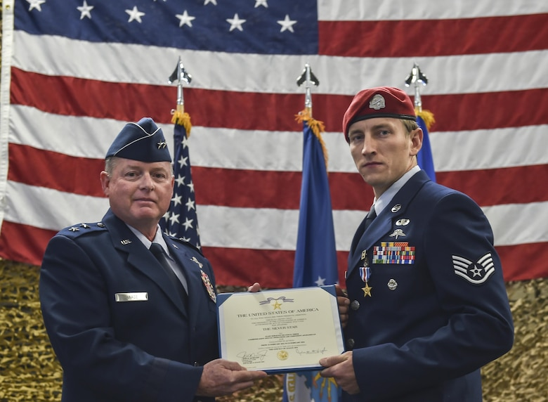 Maj. Gen. Eugene Haase, vice commander of Air Force Special Operations Command, presents Staff Sgt. Keaton Thiem, a combat controller with the 22nd Special Tactics Squadron, the Silver Star Medal at Joint Base Lewis-McChord, Wash., Nov. 16, 2016. Thiem used air power to ensure the safety of his 100-plus man SOF element during a 14-hour firefight with no regard for his own personal safety, while deployed with U.S. Army Special Operations Forces in Afghanistan.(U.S. Air Force photo by Senior Airman Ryan Conroy)