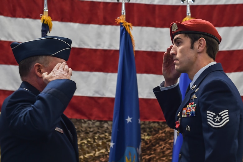 Maj. Gen. Eugene Haase, vice commander of Air Force Special Operations Command, salutes a combat controller with the 22nd Special Tactics Squadron after presenting him with the Bronze Star Medal with valor at Joint Base Lewis-McChord, Wash., Nov. 16, 2016. This Airman, while deployed with a U.S. Army Special Operations Forces team May 7, 2016, eliminated an insider attack in Afghanistan, when a gunman opened fire on joint partners. (U.S. Air Force photo by Senior Airman Ryan Conroy)