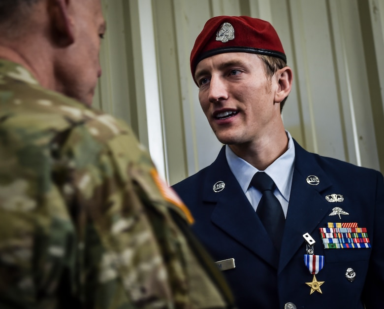 Staff Sgt. Keaton Thiem, a combat controller with the 22nd Special Tactics Squadron, shakes hands with visitors following his Silver Star Medal presentation ceremony at Joint Base Lewis-McChord, Wash., Nov. 16, 2016. Thiem used air power to ensure the safety of his 100-plus man SOF element during a 14-hour firefight with no regard for his own personal safety, while deployed with U.S. Army Special Operations Forces in Afghanistan. (U.S. Air Force photo by Senior Airman Ryan Conroy)