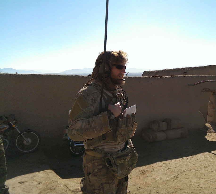 Staff Sgt. Keaton Thiem controls aircraft during a drug/weapons cache clearing mission in Helmand province, Afghanistan. The Silver Star Medal was presented to Thiem, a combat controller with the 22nd Special Tactics Squadron, for using air power to ensure the safety of his 100-plus man SOF element during a 14-hour firefight with no regard for his own personal safety, while deployed with U.S. Army Special Operations Forces in Afghanistan. (Courtesy photo/released)