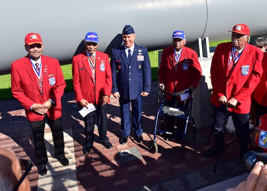 Brig. Gen. Brook Leonard, 56th Fighter Wing commander, stands with original Tuskegee Airmen, Nov. 11 during a ceremony unveiling a red tail granite paver, honoring Tuskegee Airmen experience at the Wesley Bolin Plaza, Phoenix, Arizona. (U.S. Air Force photo by Tech. Sgt. Louis Vega Jr.)