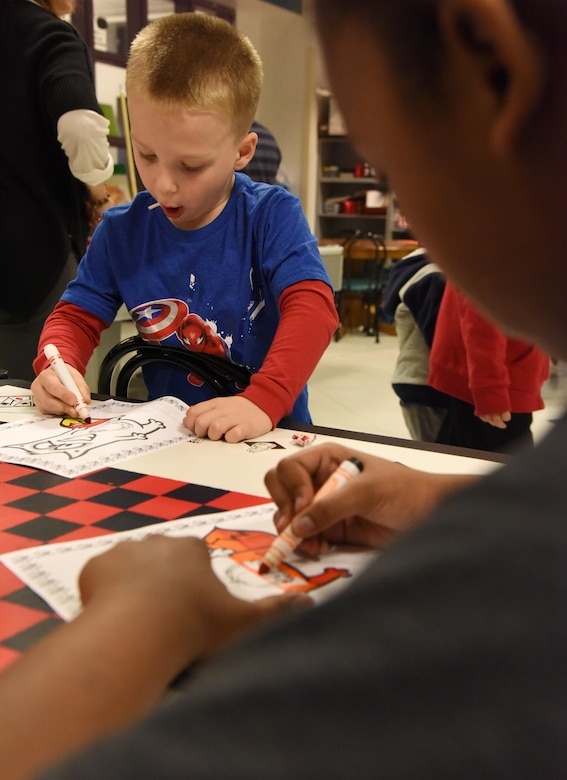 Jackson Sproston, son of Maj. Devin Sproston, 81st Security Forces Squadron commander, participates in a coloring contest during a Town Hall meeting and Children's Carnival event at the Youth Center Nov. 15, 2016, on Keesler Air Force Base, Miss. The event included a Q-and-A session with base leadership, updates from the Keesler Medical Center, family housing  and 81st Force Support Squadron, as well as dinner and entertainment for children of those who attended. (U.S. Air Force photo by Kemberly Groue/Released)