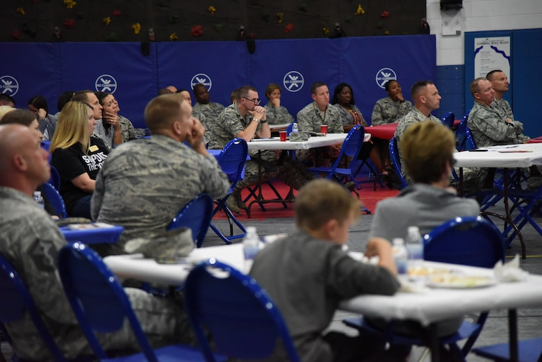 Keesler personnel attend a Town Hall meeting and Children's Carnival event at the Youth Center Nov. 15, 2016, on Keesler Air Force Base, Miss. The event included a Q-and-A session with base leadership, updates from the Keesler Medical Center, family housing and 81st Force Support Squadron, as well as dinner and entertainment for children of those who attended. (U.S. Air Force photo by Kemberly Groue/Released)