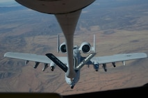 An A-10C Thunderbolt II assigned to the 354th Fighter Squadron, Davis-Monthan Air Force Base, Ariz., prepares to receive fuel from a KC-135R Stratotanker from the 91st Air Refueling Squadron, MacDill Air Force Base, Fla., over southeastern Ariz., Nov. 15. 2016.  Both squadrons are participating in the Cactus Flag exercise, a large-force exercise that tests 355th Fighter Wing's readiness and compliance. (U.S. Air Force photo by Senior Airman Betty R. Chevalier)