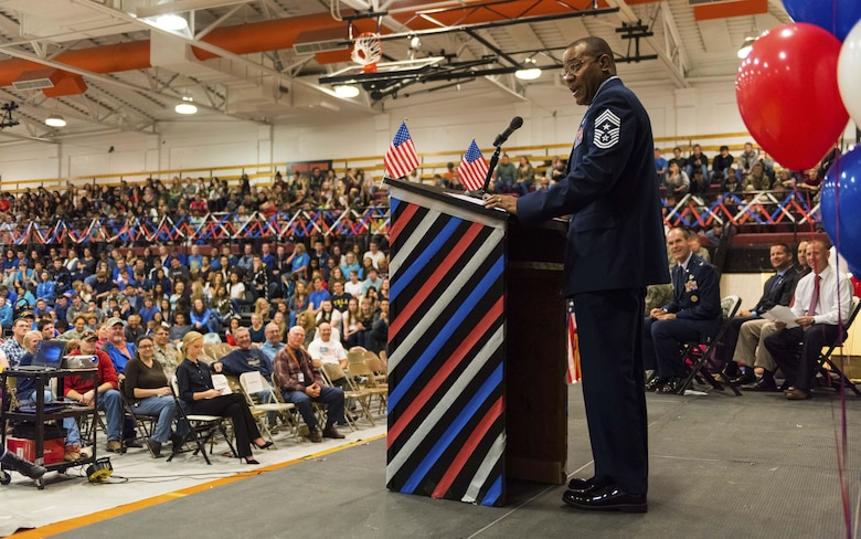 "Chief Master Sgt. David Brown, 366th Fighter Wing command chief, speaks to students and staff at Mountain Home High School at Mountain Home, Idaho, Nov. 11, 2016. ""We are the land of the free, because we are the home of the brave!"" Brown said during his speech. (U.S. Air Force photo by Senior Airman Connor J. Marth/Released)"