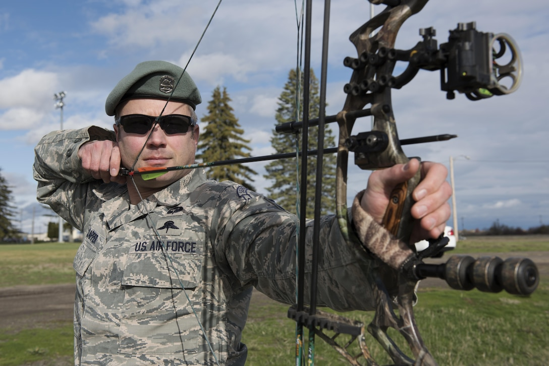 Master Sgt. Jason Clapper, 22nd Training Squadron resistance and advanced skills training superintendent, aims at his target Nov. 1, 2016 at Fairchild Air Force Base, Wash. Clapper has dedicated three years to develop the Survival Archery range. (U.S. Air Force photo/Senior Airman Nick J. Daniello)