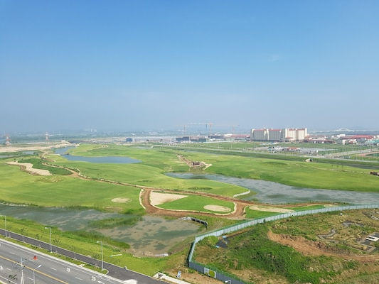 Photo was taken atop a water tower at Camp Humphreys on July 19 and show many of the Far East District's current projects there. You can see the new golf course, commissary, post exchange, flag level housing, and other facilities taking shape.