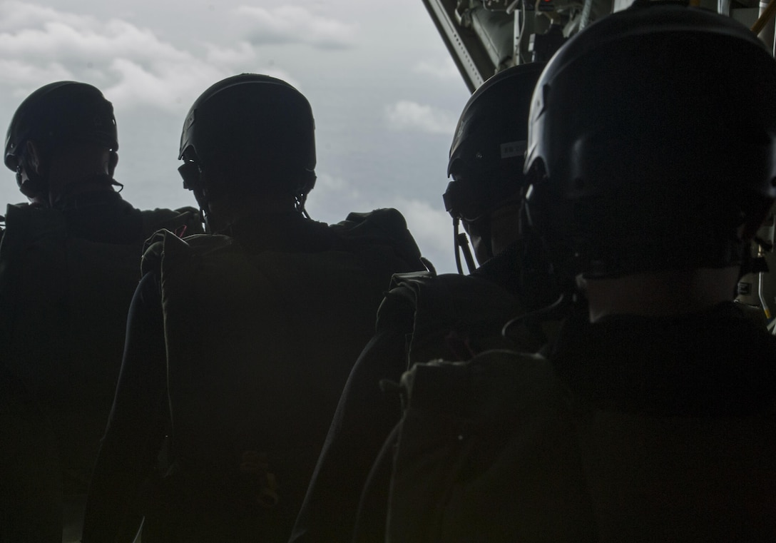 Japan Air Self-Defense Force pararescuemen prepare to jump out of an MC-130J Commando II during Exercise Keen Sword 17 Nov. 10, 2016, off the coast of Okinawa, Japan. During Keen Sword, pararescuemen respond to scenarios such as a downed aircraft simulation over the Pacific Ocean. (U.S. Air Force photo by Senior Airman Lynette M. Rolen/Released)