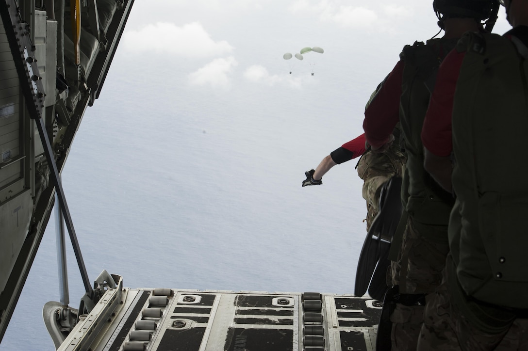 U.S. Air Force pararescuemen from the 31st Rescue Squadron jump out of an MC-130J Commando II during Exercise Keen Sword 17 Nov. 10, 2016, off the coast of Okinawa, Japan. Exercises like Keen Sword demonstrate the ability of rescue teams to quickly gather resources and respond to a situation. (U.S. Air Force photo by Senior Airman Lynette M. Rolen/Released)